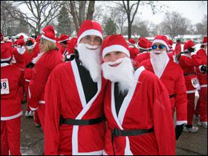 <image:Steven and Kim as Santa Runners;