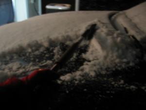 scraping snow off car
