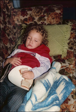 image:Young Kim asleep with PB sandwich in her hand